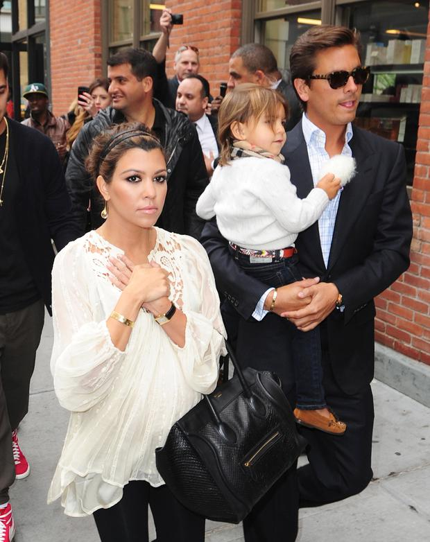 NEW YORK, NY - APRIL 23: (L-R) Kourtney Kardashian, Scott Disick and Mason Disick are seen on the Streets of Manhattan on April 23, 2012 in New York City. (Photo by Alo Ceballos/FilmMagic)