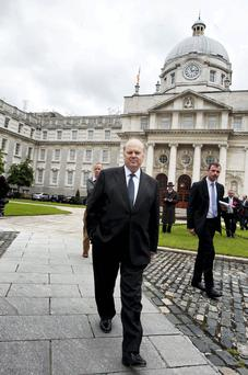 Michael Noonan leaves Government Buildings after speaking about having a cancerous lump removed from his arm. Photo: Tom Burke