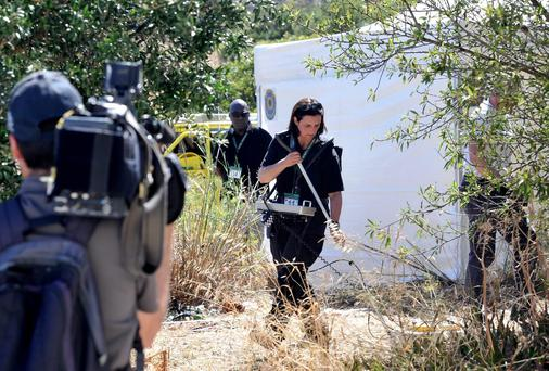 A British police officer uses a radar as part of a new investigation into the disappearance of Madeleine McCann in Praia da Luz, Portugal