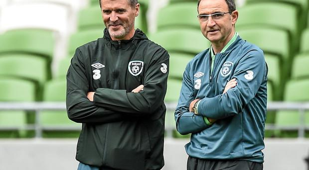 Ireland manager Martin O'Neill, right, speaks with assistant manager Roy Keane during training at the Aviva Stadium