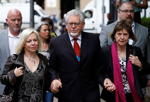 Entertainer Rolf Harris arrives with his daughter Bindi (L) and niece Jenny at Southwark Crown Court in London. Harris is charged with 12 counts of indecent assault, and denies all the charges