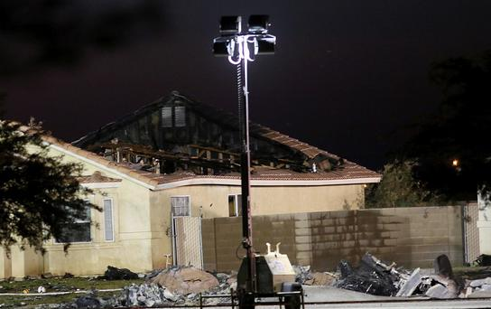 A damaged house is seen at the scene of a U.S. military jet crash in Imperial