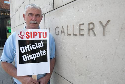National Gallery Staff Peter Judge during a strike due to a dispute with management of the National Gallery outside the building in Dublin's City Centre, Dublin. Photo: Gareth Chaney Collins