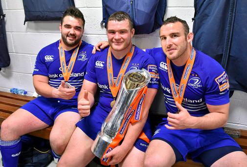 Leinster players, from left, Martin Moore, Jack McGrath and Aaron Dundon celebrate with the Pro 12 trophy