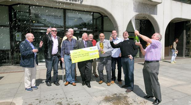 A lucky syndicate of 21 people from Navan, Co. Meath won last Saturday's Lotto Plus 2 top prize of €250,000. 10 of the delighted 'Tierney's Football Pools Syndicate' collected the big cheque at The National Lottery offices yesterday. Pictured celebrating are, from left: Frank Cahill, Ray Mooney, Jim Finnegan, Jack Kiernan, Joe Tierney, Patrick Gallagher, Tony Crocock, Karl Mooney, Paddy Stapleton and Colm Curtis. The syndicate have been playing the Lotto together since the game began in 1988 and today take home their winnings of €11,904.76 each. Picture: Mac Innes Photography.
