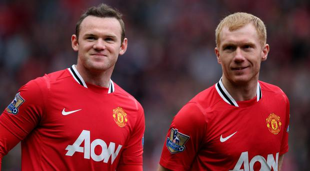 Paul Scholes and former Manchester United teammate Wayne Rooney