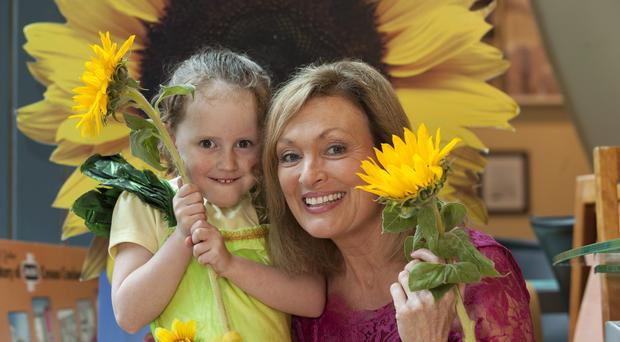 Five year old Saoirse Martin from Blessington, Co Wicklow and RTE's Mary Kennedy at the Irish Hospice Foundation (IHF) announcement that the national Hospice Sunflower Days collection, for local hospice services, will take place on Friday 6th and Saturday 7th June. Photo: Peter Houlihan / Fennells