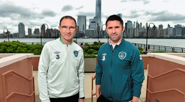 Republic of Ireland manager Martin O'Neill with captain Robbie Keane pictured against a backdrop of Manhattan ahead of their international friendly match against Costa Rica