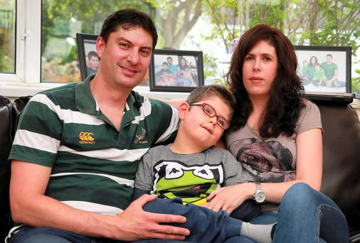 Adriaan Pretorius and wife Dianna Ross, with their son Ben at their home in Clonsilla. Picture: Arthur Carron