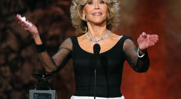 Honoree Jane Fonda accepts the AFI Life Achievement Award onstage at the 2014 AFI Life Achievement Award: A Tribute to Jane Fonda at the Dolby Theatre on June 5, 2014 in Hollywood, California. Tribute show airing Saturday, June 14, 2014 at 9pm ET/PT on TNT. (Photo by Mark Davis/Getty Images for AFI)