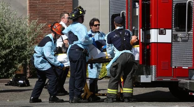 Seattle firefighters remove a victim from the scene of a shooting at Seattle Pacific University
