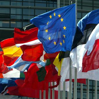 The European flag flies amongst the 25 European Union member countries' national flags