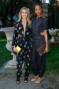 (L-R) Cara Delevingne and Jourdan Dunn attend the Stella McCartney Spring 2015 Presentation at Elizabeth Street Gardens