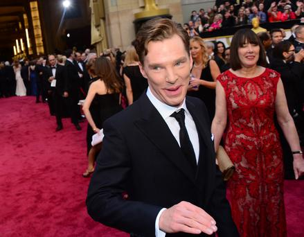 Actor Benedict Cumberbatch arrives on the red carpet at the 86th Academy Awards on March 2nd, 2014 in Hollywood, California.