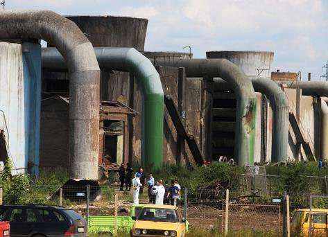 Forensic experts inspect the site of a explosion at Kosova A power plant in Obilic near Pristina
