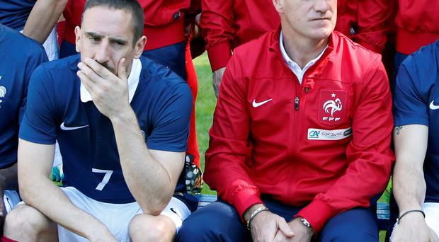 France's forward Franck Ribery, left, and head coach Didier Deschamps pose for the team picture at the French national football team's training base, in Clairefontaine, outside Paris