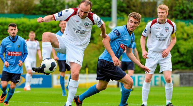 Galway's Martin Colleely hold the ball from UCD's Thomas O'Halloran in their FAI Ford Cup second round game. Photo: Piaras O Midheach / SPORTSFILE