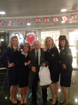 Bernard onboard a ferry to France with a cabin crew and members of the Candy Girls entertainment troupe