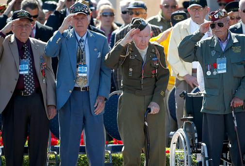 US veterans salute at the Normandy American Cemetery