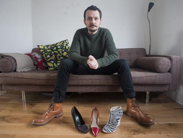 If the shoe fits: Liam Fahy at home in London surrounded by some of his