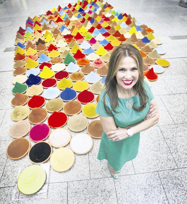 Artist and former Miss Bolivia Sonia Falcone pictured with her piece Campo de Colore featuring 300 bowls filled with spices in the CHQ Building Dublin.