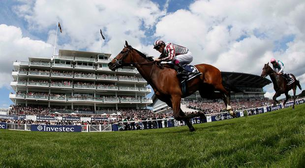 Cirrus Des Aigles ridden by Christophe Soumillon races for the finish line to win The Coronation Cup during the Epsom Derby festival