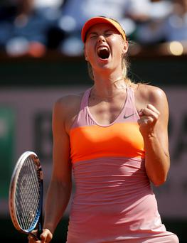 Maria Sharapova of Russia reacts during her women's singles final match against Simona Halep of Romania at the French Open tennis tournament at the Roland Garros stadium in Paris June 7, 2014. REUTERS/Gonzalo Fuentes