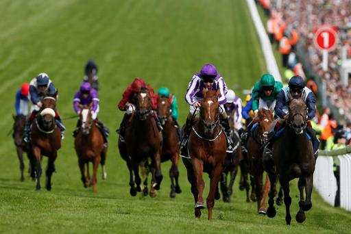 Australia ridden by Joseph O'Brien (C) races for the finish line to win The Derby during the Epsom Derby festival in Epsom
