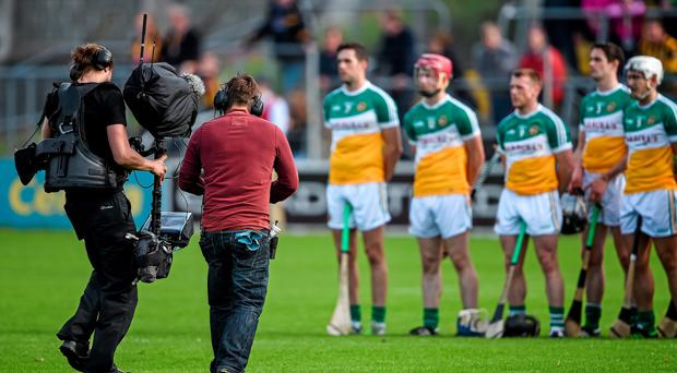 A Sky Sports TV cameraman films the Offaly team during the national anthem before the game.