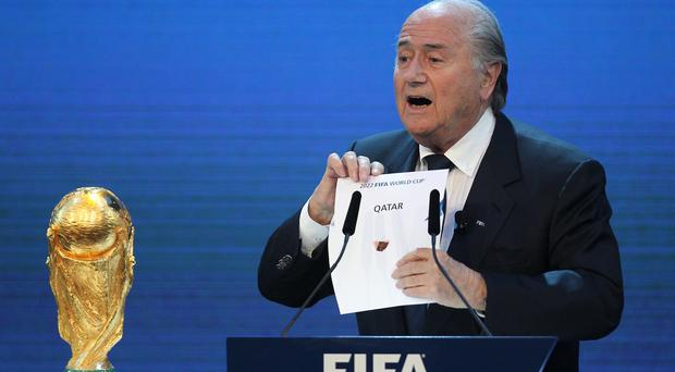 FIFA president Joseph Blatter opens the envelope to reveal that Qatar will host the 2022 World Cup at the FIFA headquarters in Zurich four years ago.