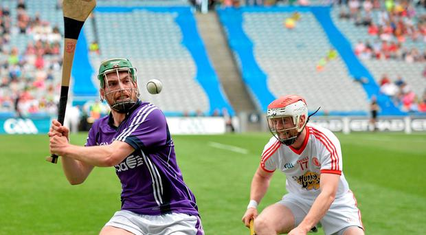 Niall Ring, Fingal, in action against Seán Óg Grogan, Tyrone