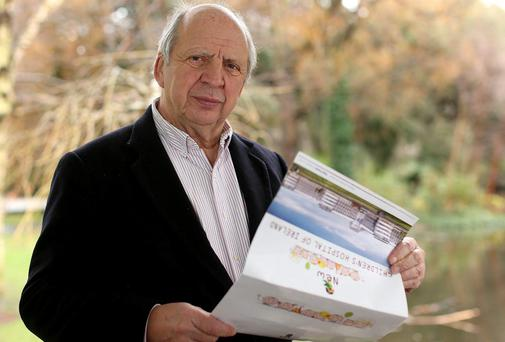 Jonathan Irwin with plans for the Children's Hospital. Picture: GERRY MOONEY