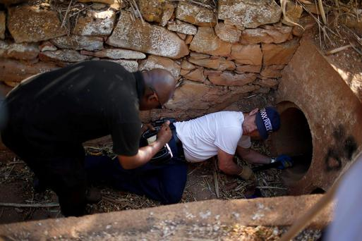 Members of Scotland Yard insert a camera inside a sewer during the search for missing British girl Madeleine McCann in Praia da Luz, near Lagos,. McCann was three when she disappeared from her room at the Praia da Luz holiday resort in the Algarve in May 2007 while her parents were dining with friends at a nearby restaurant, prompting a global hunt and worldwide headlines.