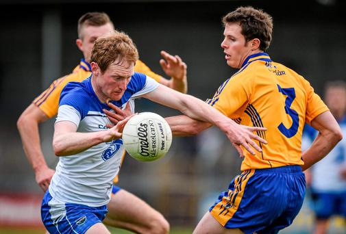 Waterford's Liam Ó Lonáin turns past his Clare marker Kevin Hartnett during their Munster SFC clash at Cusack Park yesterday. Photo: Barry Cregg / SPORTSFILE