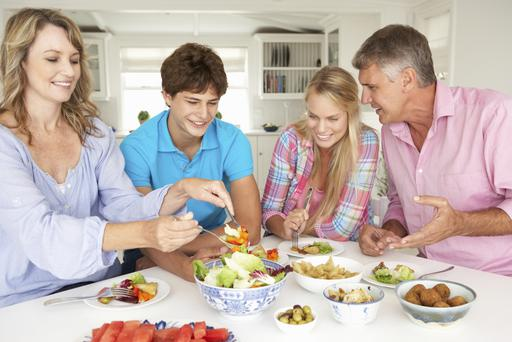 The family that eats together. Photo: Getty Images.