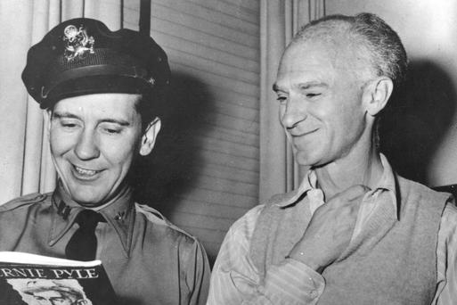 Ernie Pyle, right, shows his book 'Here is Your War' to actor Burgess Meredith