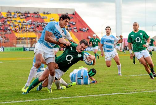 Jonathan Sexton goes over for Ireland's second try against Argentina despite a tackle from Manuel Montero. Photo: Stephen McCarthy / SPORTSFILE