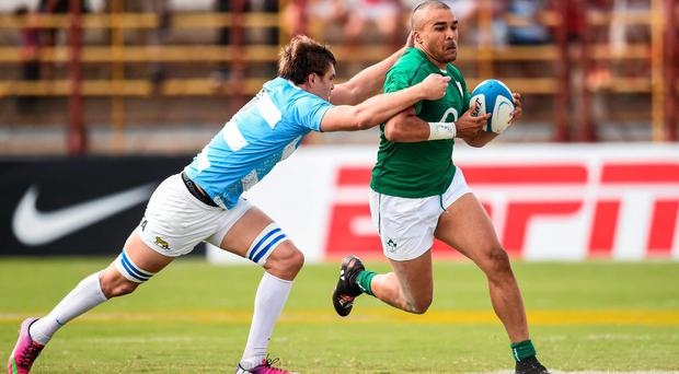 Ireland winger Simon Zebo is tackled by Rodrigo Baez of Argentina. Photo: Stephen McCarthy / SPORTSFILE