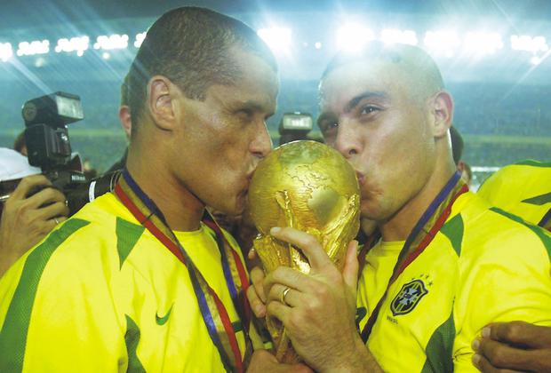 CAN HISTORY REPEAT ITSELF? Rivaldo and Ronaldo kiss the trophy after Brazil beat Germany in the World Cup Final in Japan in 2002. Brazil are favourites this year. Photo: Alex Livesey