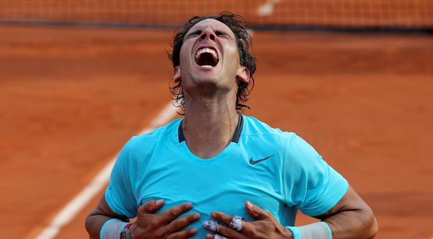 Spain's Rafael Nadal reacts after defeating Serbia's Novak Djokovic in the French Open Final.