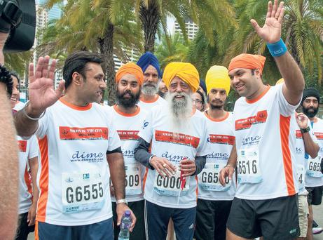 A man for all the ages: Fauja Singh completes another 10K run in Hong Kong last year. In 2011, he completed the Toronto marathon. He was 100 years old.
