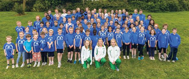 Members of Skerries AC with club members who have competed for Ireland Rhona Pierce, Ciara Durkan and Isabelle Carron.