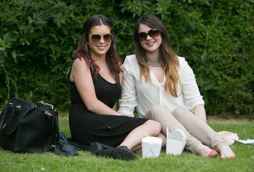 Rachel Stuart from Portmarnock & Ciara Macken from Sutton enjoying the good weather on Merrion Square, Dublin over the weekend. Photo: Gareth Chaney Collins