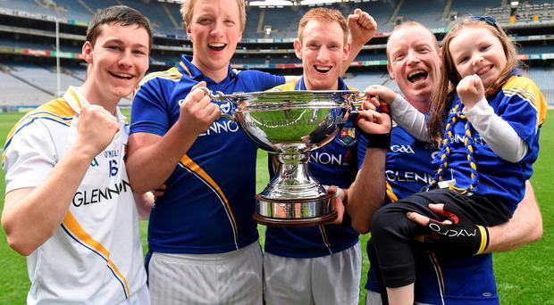 Longford players (from left) John Mulhern, Dermot Kiernan, captain Martin Coyle and Declan Tanner and his four year old daughter Lucy celebrate with the Lory Meagher Cup after their win over Fermanagh. Photo: Matt Browne / SPORTSFILE