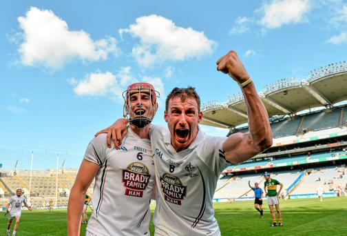 Kildare's Mark Moloney (left) and Éanna Ó Neill celebrate after the the final whistle is blown at the Christy Ring Cup final at Croke Park. Photo: Piaras O Midheach / SPORTSFILE