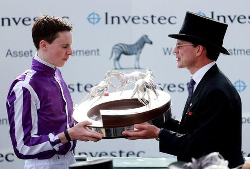 Joseph and Aidan O'Brien with the Derby trophy after Australia's victory in the Derby at Epsom. Photo: David Davies/PA Wire