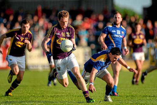 Kevin O'Grady, Wexford, in action against Shane Mulligan, Longford
