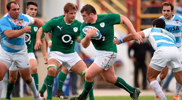 Jack McGrath breaks through a tackled by Gabriel Ascarate of Argentina during the first Test of Ireland's summer tour 2014. Photo: Stephen McCarthy / SPORTSFILE
