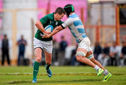 Jonathan Sexton is tackled by Tomás De la Vega of Argentina during the first Test of Ireland's summer tour. Photo: Stephen McCarthy / SPORTSFILE