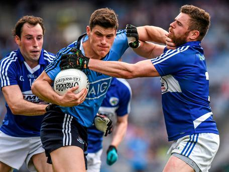 Diarmuid Connolly, Dublin, is tackled by Laois players Conor Meredith, left, and Paul Begley. Leinster GAA Football Senior Championship, Quarter-Final, Dublin v Laois, Croke Park, Dublin. Picture credit: Ray McManus / SPORTSFILE